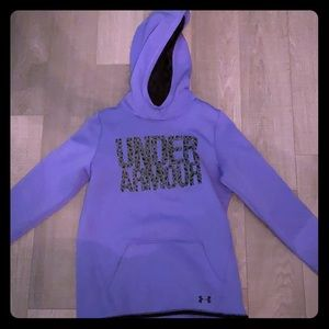 A purple under armour hoodie